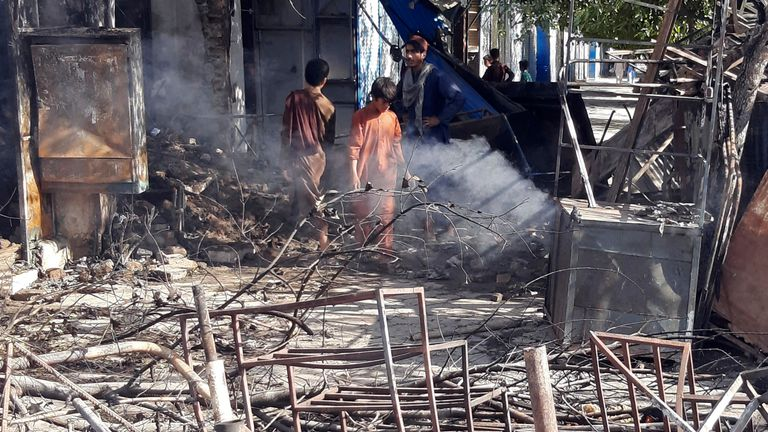 Fighting between Taliban and Afghan security forces in Kunduz destroyed buildings and shops. Pic: AP