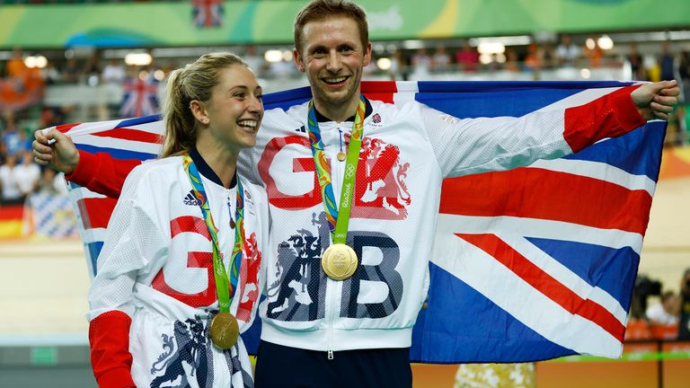 Laura Trott, left, and her fiance Jason Kenny, right, both of Britain, pose with their gold medals at the Rio Olympic Velodrome during the 2016 Summer Olympics in Rio de Janeiro, Brazil, Tuesday, Aug. 16, 2016. Kenny won the men's keirin cycling final and Trott won gold in the women's omnium race.(AP Photo/Patrick Semansky)