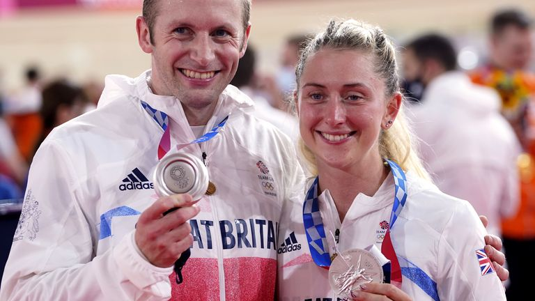 Laura and Jason Kenny with their silver medals for the Women's Team Pursuit and Men's Team Sprint in the Tokyo Velodrome