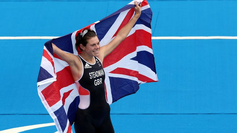 Tokyo 2020 Paralympic Games - Triathlon - Women's PTS5 - Odaiba Marine Park, Tokyo, Japan - August 29, 2021. Lauren Steadman of Britain celebrates winning the gold medal with the flag of Britain REUTERS/Bernadett Szabo
