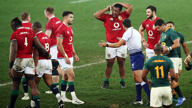Rugby Union - Third Test - South Africa v British and Irish Lions - Cape Town Stadium, Cape Town, South Africa - August 7, 2021 Referee Mathieu Raynal speaks with British and Irish Lions' Conor Murray REUTERS/Mike Hutchings