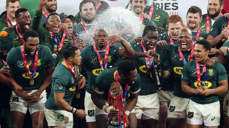 Rugby Union - Third Test - South Africa v British and Irish Lions - Cape Town Stadium, Cape Town, South Africa - August 7, 2021 South Africa's Siya Kolisi lifts the trophy as they celebrate winning the series REUTERS/Mike Hutchings