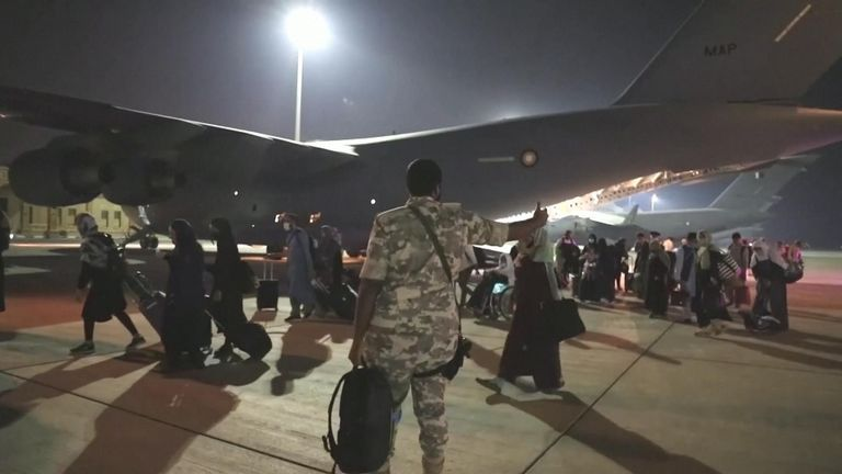 Afghan refugees landed in Doha, Qatar, on their way to sanctuaries such as Canada