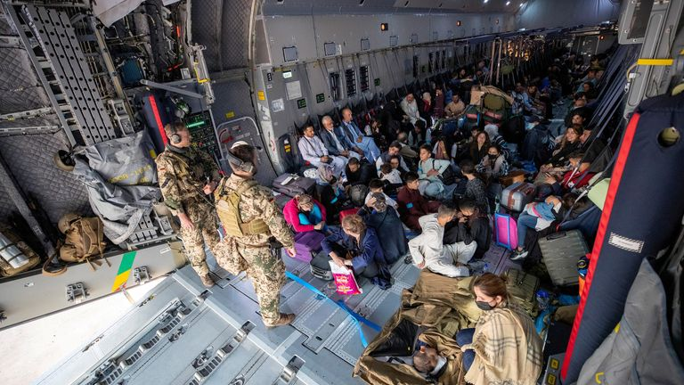 A handout photo obtained from Twitter via @Bw_Einsatz on August 17, 2021 shows evacuees from Afghanistan as they arrive in an Airbus A400 transport aircraft of the German Air Force Luftwaffe in Tashkent, Uzbekistan. Marc Tessensohn/Twitter @Bw_Einsatz/Handout via REUTERS ATTENTION EDITORS - THIS IMAGE HAS BEEN SUPPLIED BY A THIRD PARTY NO RESALES. NO ARCHIVES