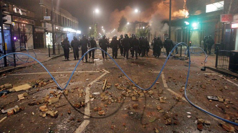 Riot police form a line in Tottenham, north London