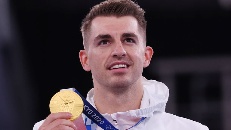 Max Whitlock poses with his gold medal in Tokyo