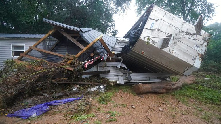 Some of the damage to property caused by Saturday's flooding in McEwen, Tennessee. Pic: AP