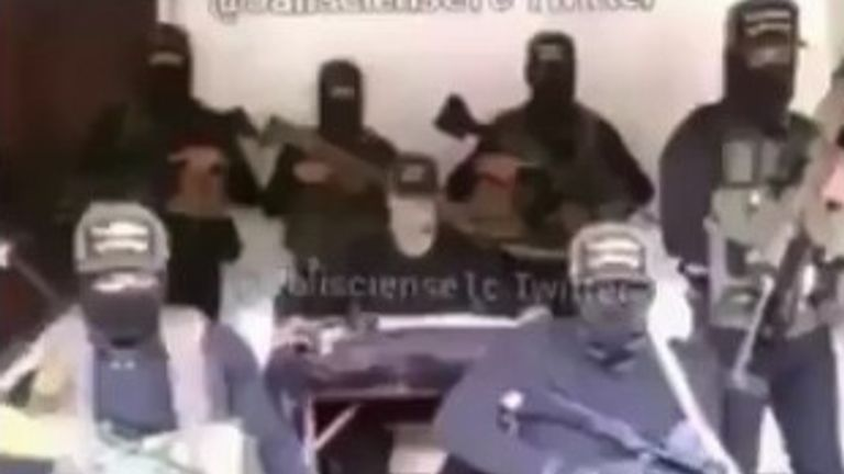 Masked men claiming to represent Mexico's most powerful cartel have appeared in a video online, threatening a news presenter