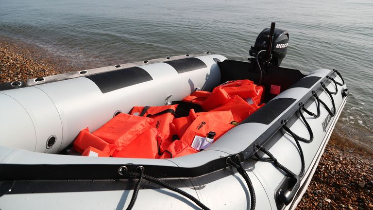 Lifejackets in an inflatable boat at Kingsdown beach, near Dover, Kent, where it was abandoned by people thought to be migrants who had used it to cross the English Channel.