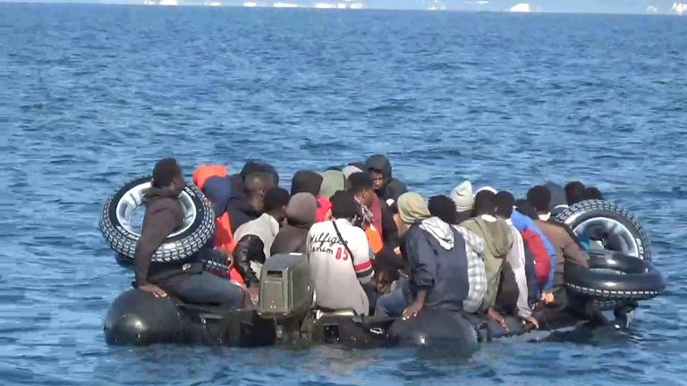 Migrants crossing channel in rubber dinghy with tyres around their bodies