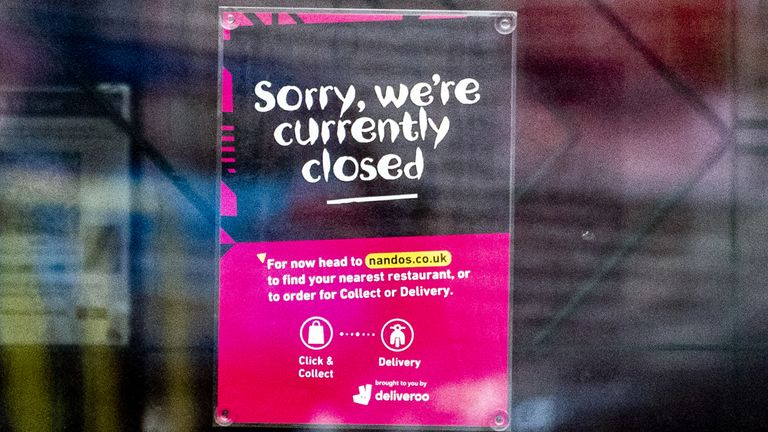 A sign on the doors of a branch of Nando's in White City, Manchester, telling customers that the store is closed. The chain has had to temporarily close around 50 of its restaurants nationwide after running out of peri-peri chicken. Picture date: Wednesday August 18, 2021.