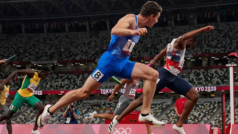 Filippo Tortu, of Italy, runs to the finish line ahead of Nethaneel Mitchell-Blake, of Britain, to lead his to team a gold medal in the men...s 4x100-meter relay at the 2020 Summer Olympics, Friday, Aug. 6, 2021, in Tokyo. (AP Photo/David J. Phillip)