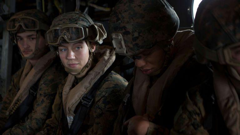 U.S. Marine Corps Corporal Nicole Gee, a maintenance technician with 24th Marine Expeditionary Unit (MEU), awaits the launch of an MV-22B Osprey during an en route care exercise aboard the Wasp-class amphibious assault ship USS Iwo Jima (LHD-7), April 5, 2021. Staff Sgt. Mark E Morrow Jr/U.S. Marine Corps/Handout via REUTERS