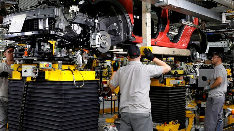 Workers are seen on the production line at Nissan's car plant in Sunderland, Britain, October 10, 2019.