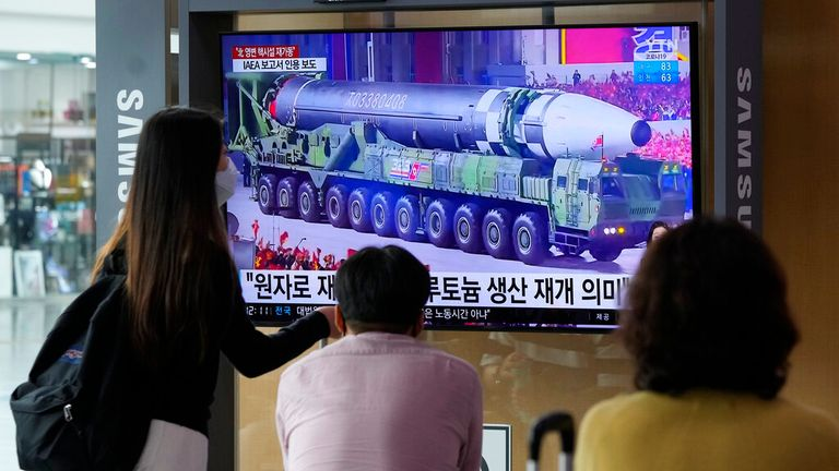 People watch a nuclear missile being paraded through North Korea on TV in Seoul.Pic: AP