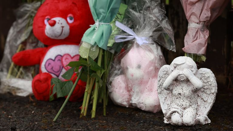 Flowers and soft toys left at the scene in Dungannon, Co Tyrone, where a two-year-old who was found injured on Friday afternoon was rushed to hospital and later died. A 32-year-old man was arrested on suspicion of her murder. Picture date: Sunday August 8, 2021.