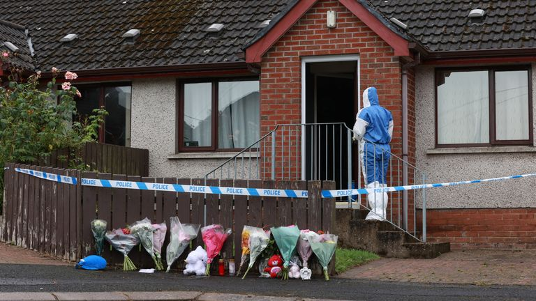 Forensics officers at the scene in Dungannon, Co Tyrone, where a two-year-old who was found injured on Friday afternoon was rushed to hospital and later died. A 32-year-old man was arrested on suspicion of her murder. Picture date: Sunday August 8, 2021.