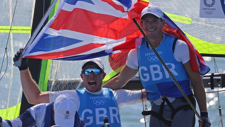 Dylan Fletcher and Stuart Bithell celebrate winning gold in the 49er class