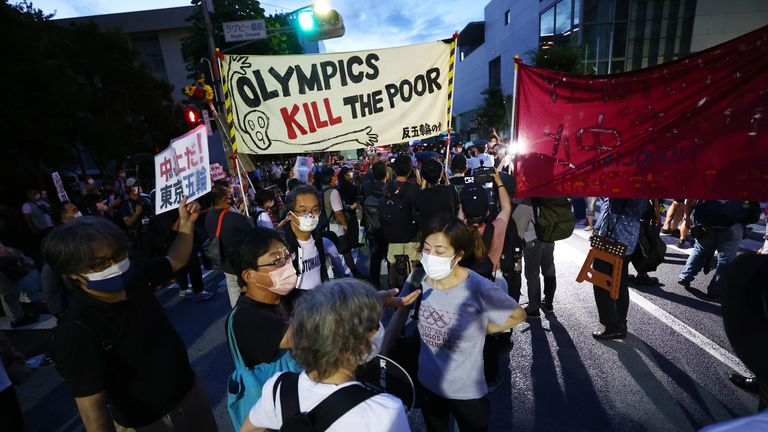 Protesters against the Olympic Games demonstrate outside the Olympic Stadium, ahead of the Tokyo 2020 Olympics Closing Ceremony in Tokyo, Japan August 8, 2021. REUTERS/Issei Kato