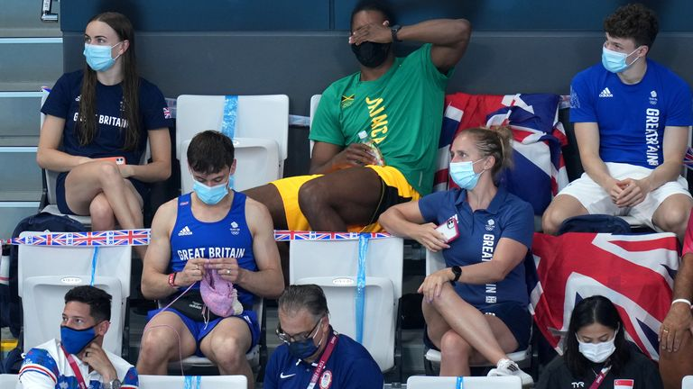 Great Britain's Tom Daley knits in the stands during the Women's 3m Springboard Final