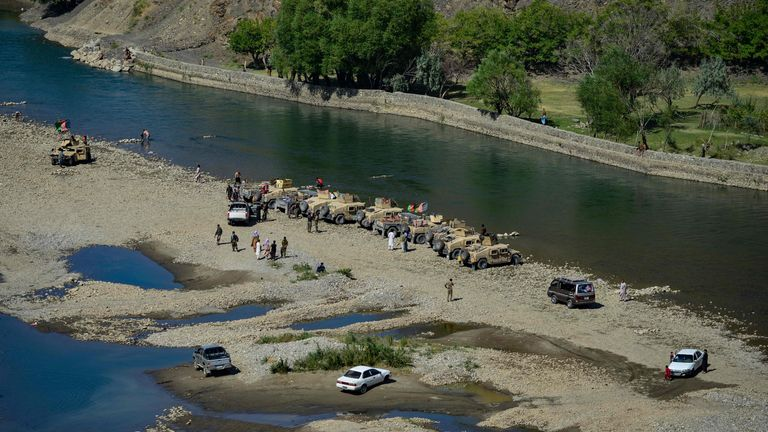 This image captured on Monday shows Humvees lined up on the banks of the Panjshir river. Pic: Ahmad Sahel via Getty Images