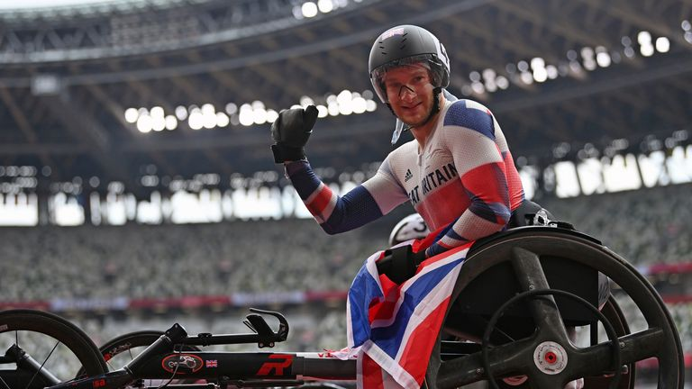 Great Britain's SMALL Andrew poses for photo after winning the Men's 100m - T33 Final at the Summer Paralympic Games in Tokyo on Aug. 30, 2021. ( The Yomiuri Shimbun via AP Images )