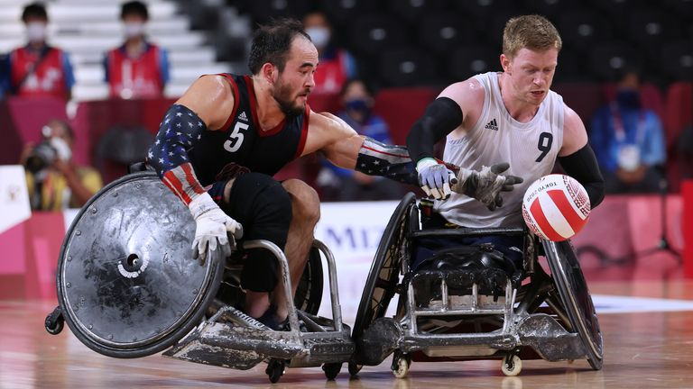 Tokyo 2020 Paralympic Games - Wheelchair Rugby - Mixed - Gold Medal - United States v Britain - Yoyogi National Stadium, Tokyo, Japan - August 29, 2021. Charles Aoki of the United States in action with Jim Roberts of Britain. REUTERS/Kim Kyung-Hoon