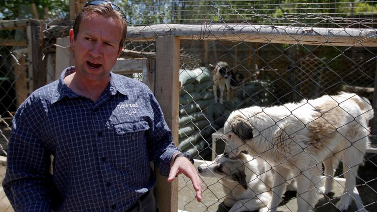 FILE PHOTO: Pen Farthing, founder of British charity Nowzad, an animal shelter, stands in front of a cage on the outskirts of Kabul May 1, 2012. A former Royal Marine, Farthing adopted his dog Nowzad, named after a Helmand district, during his tour there in 2006. He then set up the charity, where dogs and some cats are neutered and vaccinated against rabies before their journeys abroad. Nowzad has given homes to over 330 dogs since it was founded, mostly to soldiers from the U.S. and Britain, bu