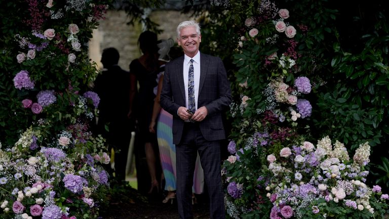 Phillip Schofield arrives for Ant McPartlin's wedding.