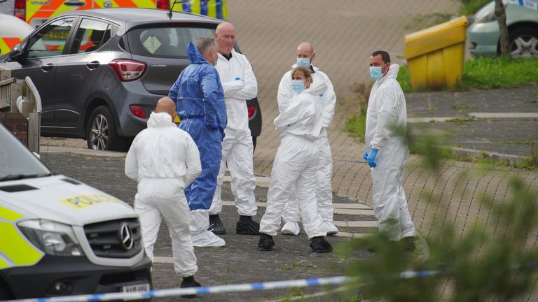 Forensic officers in Biddick Drive in the Keyham area of Plymouth where six people