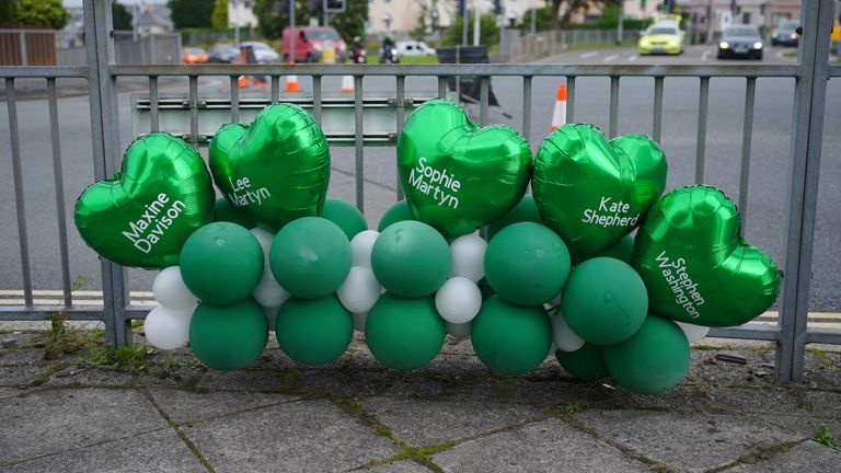 Balloons in Plymouth bear the names of Thursday's victims
