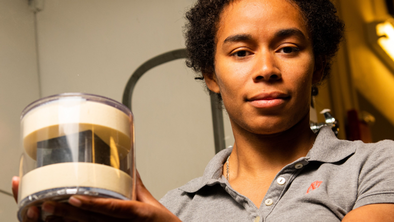 Robertson with PNNL's uranium cube, which is in a protective case. Pic: Andrea Starr/PNNL