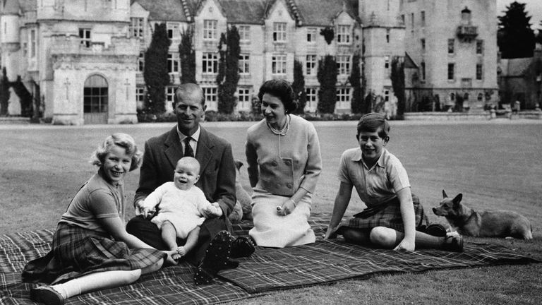 Pic: AP FILE - In this Sept. 1960 file photo, Britain's Queen Elizabeth II, Prince Philip and their children, Prince Charles, right, Princess Anne and Prince Andrew, pose for a photo on the lawn of Balmoral Castle, in Scotland. (AP Photo/File)