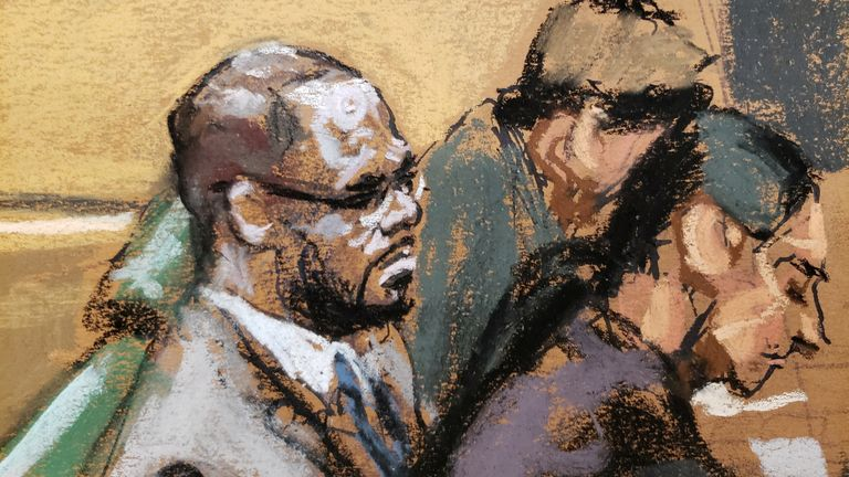 R Kelly pictured in a courtroom sketch attending Brooklyn's Federal District Court during the start of his trial in New York