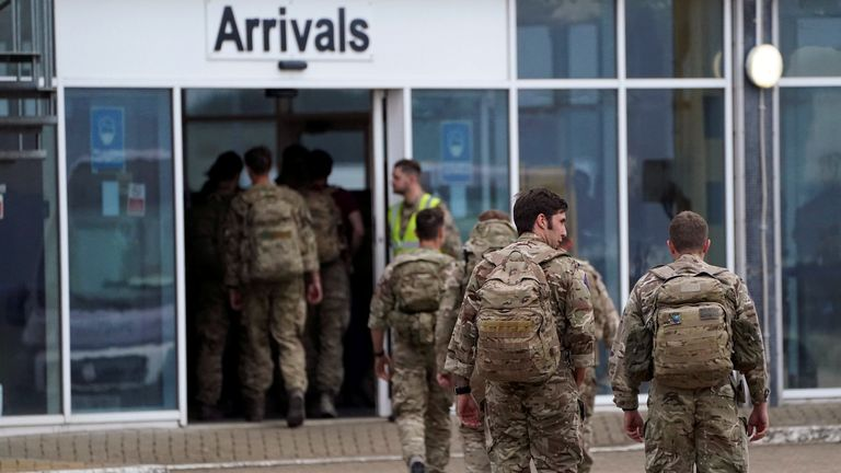 Members of the British armed forces arrive at RAF Brize Norton base