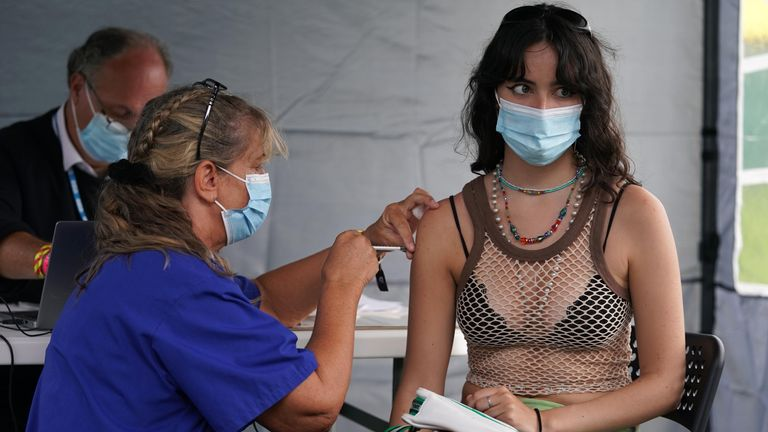 16 year old festival goer Sofia Parkinson getting a vaccine jab at a walk-in Covid-19 vaccination clinic at the Reading Festival at Richfield Avenue. Picture date: Thursday August 26, 2021.