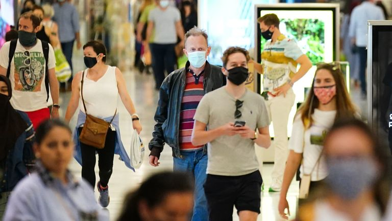 Shoppers wearing facemasks inside a shopping centre in East London, during the easing of lockdown restrictions in England. Picture date: Sunday July 4, 2021.