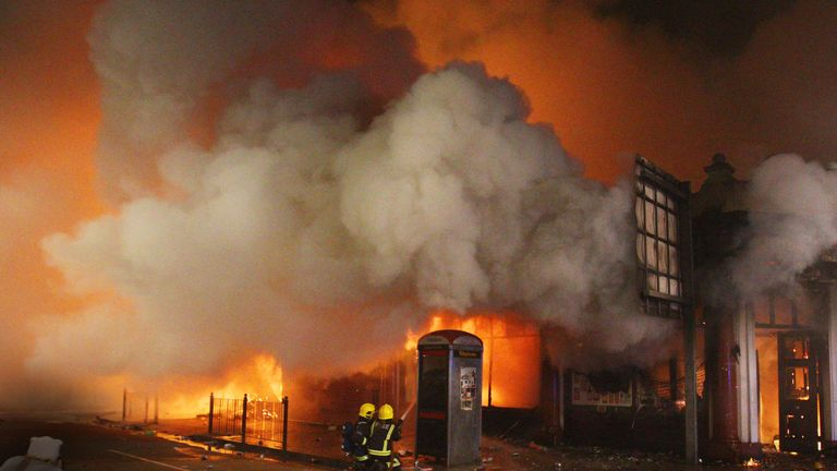 Firefighters attempt to put out a blaze in a building in Tottenham, north London