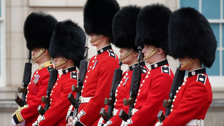 Members of the 1st Battalion the Coldstream Guards take part in the Changing of the Guard, in the forecourt of Buckingham Palace, London, for the first time since the start of the coronavirus pandemic