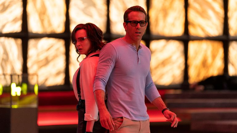 Jodie Comer as Molotov Girl and Ryan Reynolds as Guy in Free Guy. Pic: Alan Markfield/ 20th Century Studios