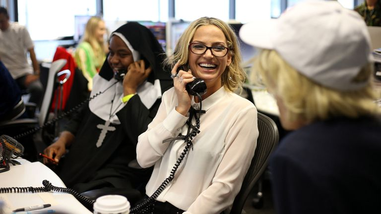 Singer Sarah Harding supporting a charity day at the London offices of Bloomberg Tradebook, where the broker is donating the day's commission to 15 good causes.