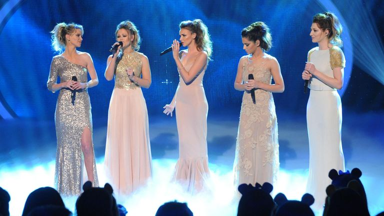 Nicola Roberts, Nadine Coyle, Kimberley Walsh, Cheryl Cole and Sarah Harding of girlband Girls Aloud live on stage during BBC Children In Need, London.