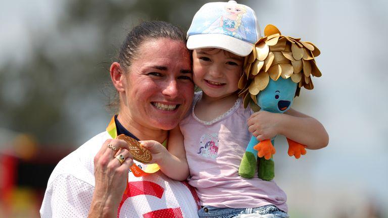 Dame Sarah Storey celebrates winning gold at Rio 2016 with her daughter Louisa