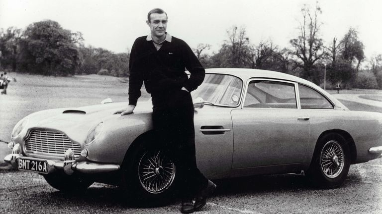 James Bond star Sean Connery pictured with the Goldfinger Aston Martin DB5 in 1964. Pic: Eon/United Artists/Kobal/Shutterstock