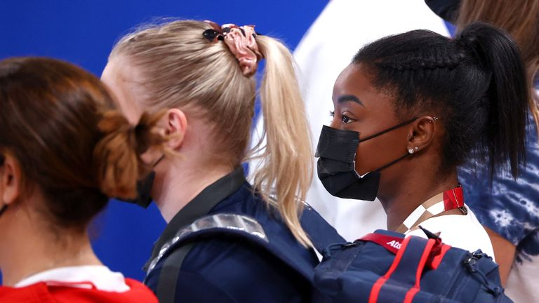 Tokyo 2020 Olympics - Gymnastics - Artistic - Women's Uneven Bars - Final - Ariake Gymnastics Centre, Tokyo, Japan - August 1, 2021. Simone Biles of the United States wearing a protective face mask looks on. REUTERS/Lindsey Wasson