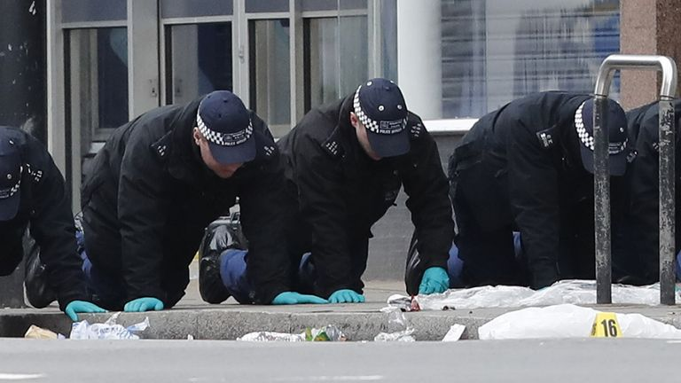 Police officers conducted a finger-tip search at the scene following the terror attack in Streatham High Road, south London.