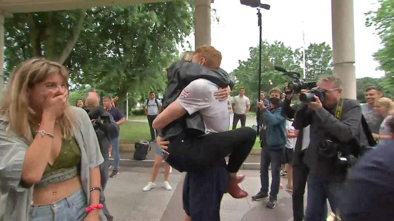 Team GB's swimmers arrive home to hugs and tears from family.