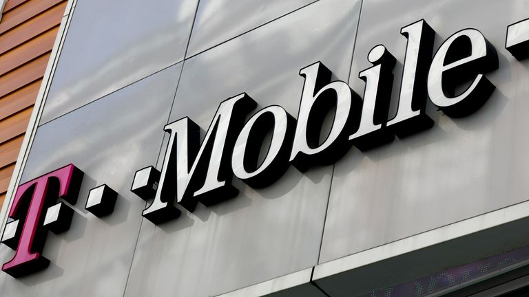 HOLD FOR MORGAN / HALL--T Mobile corporate signage is captured from a store  in Manhattan's midtown area, Tuesday, May 2, 2017, in New York. (AP Photo/Bebeto Matthews)