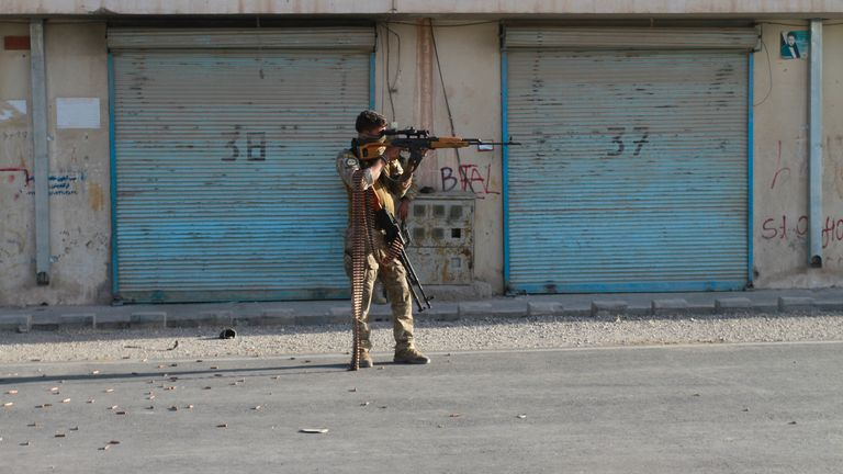 An Afghan security personnel take a position during fighting between Taliban and Afghan security forces in Herat province. Pic: AP