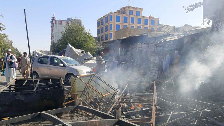 Smoke rises from damaged shops in Kunduz